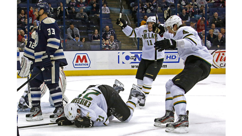 Derek Roy and Brendon Dillon celebrate as Loui Eriksson gets up off of the ice after scoring the game-winning goal during the overtime period against the Columbus Blue Jackets on February 26, 2013.  (Photo by Kirk Irwin/Getty Images)