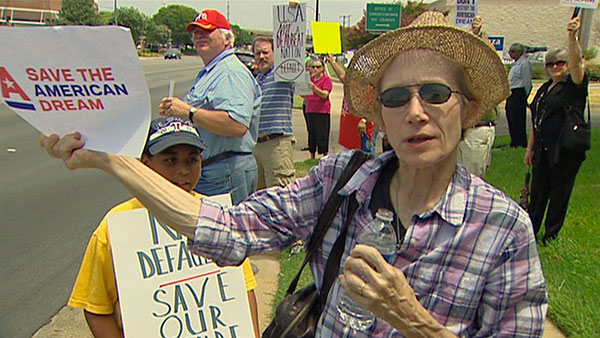 Members of MoveOn protested outside the Fort Worth office of Republican Rep. Key Granger.