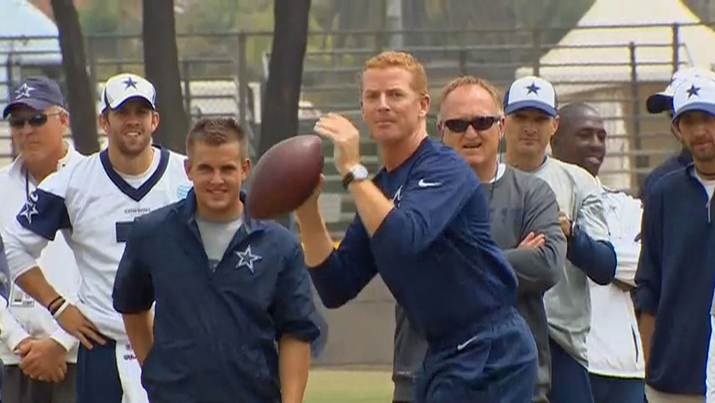 Dallas Cowboys head coach Jason Garrett tosses a football during training camp at Oxnard, California on August 14, 2013.