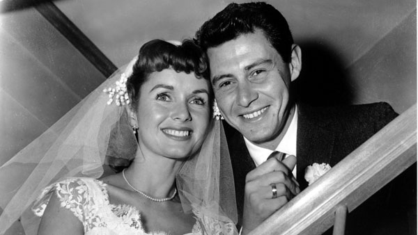 Actress Debbie Reynolds and singer Eddie Fisher smile in a pose following their brief marriage ceremony by a county judge at Grossinger, N.Y. in 1955.