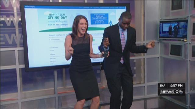 """Shelly and Marcus do """"The Wobble"""" in celebration of North Texas Giving Day."""