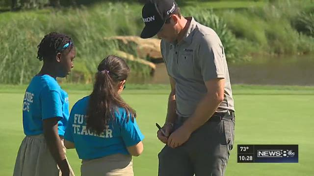 Fifth graders caddie for the pros