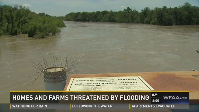 Homes, farms threatened by flooding