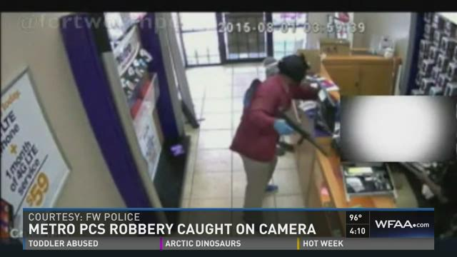 Cell phone shop robbery caught on camera