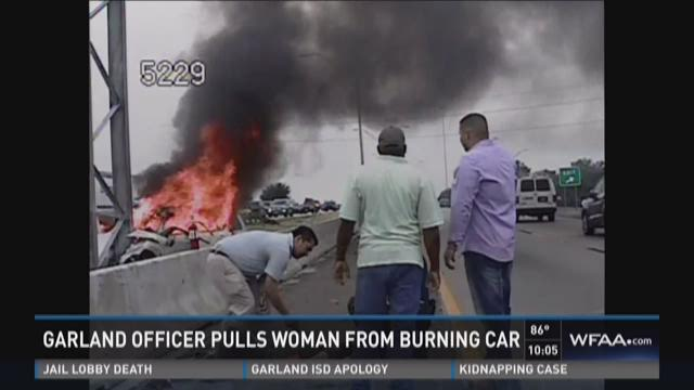 Garland officer pulls woman from burning car