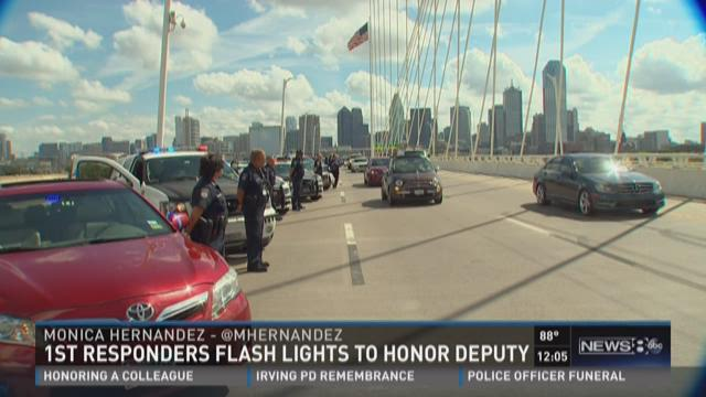 First responders flash lights to honor deputy