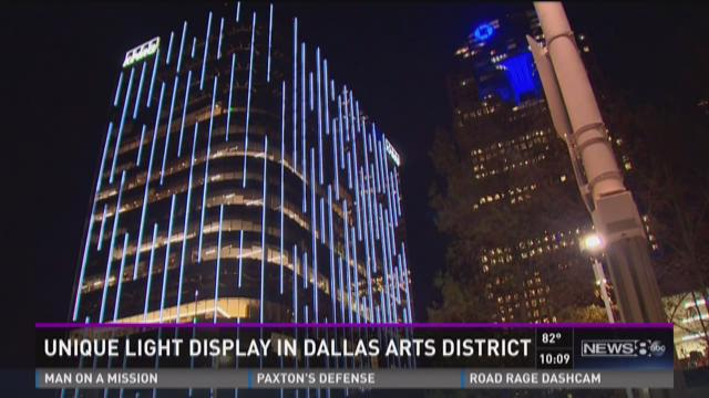 The new Hall Arts building in downtown Dallas lit up at night.