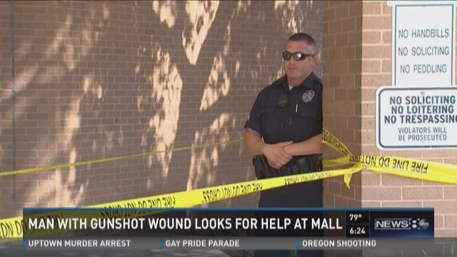 Man with gunshot wound looks for help at mall
